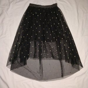Girl's black skirt.